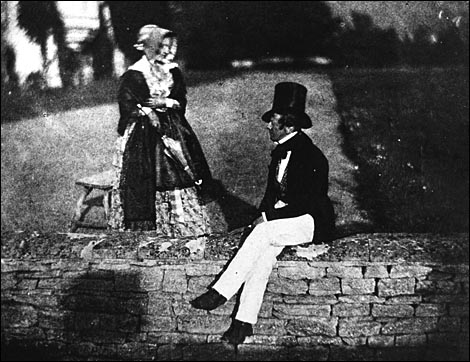 Talbot, Man and woman sitting on garden wall in Lacock Abbey, 1835